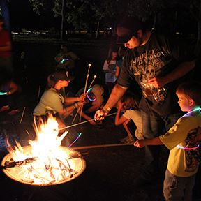 Campers Roasting Marshmallows