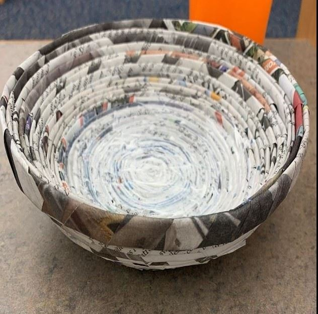 A picture of a bowl created using rolled newspaper